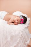 Beautiful newborn baby girl. Sleeping Royalty Free Stock Image