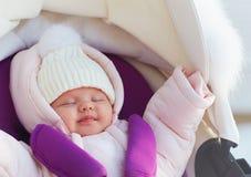 Free Beautiful Newborn Baby Girl Sleeping Peacefully In Pram During A Winter Walk Stock Image - 139951861