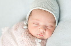 Beautiful newborn baby in hat and wrapped Stock Images
