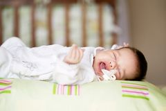 Beautiful newborn baby lying in his bed Royalty Free Stock Photo