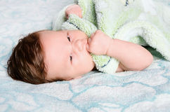 Beautiful newborn baby. Lying in his bed Stock Photography