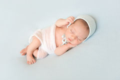 Beautiful newborn baby sleeping with hands on head Royalty Free Stock Image