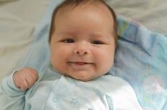 Beautiful newborn baby smiling Stock Photography