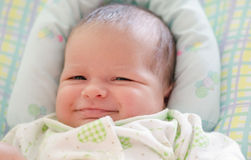Beautiful newborn baby smiling Royalty Free Stock Images
