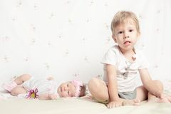 Beautiful newborn girl and young boy Royalty Free Stock Photo