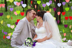 Beautiful newly married couple at the park Royalty Free Stock Images
