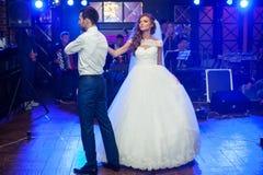 Beautiful newlywed couple first dance at wedding Stock Image