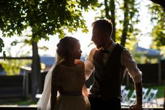 Beautiful newlywed couple looking at each other royalty free stock photography