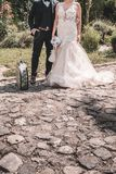 Newlywed couple with old suitcase stock photo