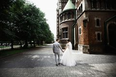 Beautiful newlywed couple walk near old christian church stock photography