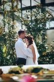 Beautiful newlywed couposing near rustic fountain. Beautiful newlywed couple posing near rustic fountain Royalty Free Stock Image