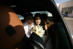Beautiful newlyweds in the car Stock Images