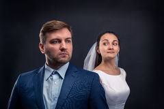 Beautiful newlyweds studio photo shoot Royalty Free Stock Photos