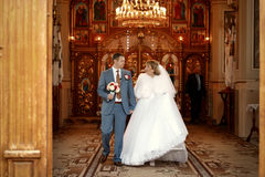 Beautiful newlyweds on wedding ceremony in the church Royalty Free Stock Image