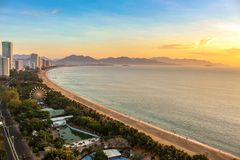 City Seascape with Aerial View of Nha Trang Beach, Mountains and Bay at Colorful Sunrise stock photos