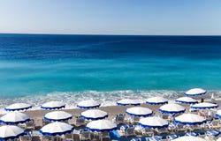 Beautiful Nice beach with umbrellas Stock Images