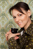 Beautiful nice woman with a cup sitting Stock Photo