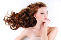 Beautiful nice woman with long ringlets hair Royalty Free Stock Photos