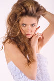 Beautiful nice woman with long ringlets hair Royalty Free Stock Photo