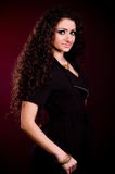 Beautiful nice woman with long ringlets hair Royalty Free Stock Photography