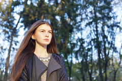 Beautiful nice woman outdoor looking at something. Closeup portr Royalty Free Stock Images