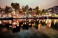 Beautiful night in Amsterdam.  illumination of buildings an Royalty Free Stock Image