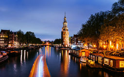 Beautiful night in Amsterdam. Night illumination of buildings an Stock Images