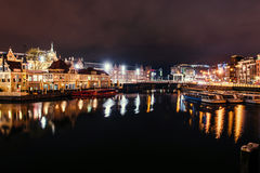 Beautiful night in Amsterdam. Night illumination of buildings an Stock Image