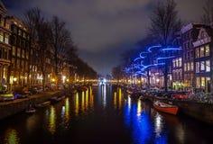 Beautiful night city canals of Amsterdam. AMSTERDAM, NETHERLANDS - JANUARY 12, 2017: Beautiful night city canals of Amsterdam. January 12, 2017 in Amsterdam Stock Photography