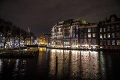 Beautiful night city canals of Amsterdam. AMSTERDAM, NETHERLANDS - JANUARY 12, 2017: Beautiful night city canals of Amsterdam. January 12, 2017 in Amsterdam Royalty Free Stock Photos