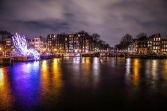 Beautiful night city canals of Amsterdam. AMSTERDAM, NETHERLANDS - JANUARY 12, 2017: Beautiful night city canals of Amsterdam. January 12, 2017 in Amsterdam Stock Photos