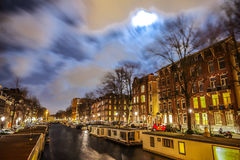 Beautiful night city canals of Amsterdam. AMSTERDAM, NETHERLANDS - JANUARY 12, 2017: Beautiful night city canals of Amsterdam. January 12, 2017 in Amsterdam Royalty Free Stock Images