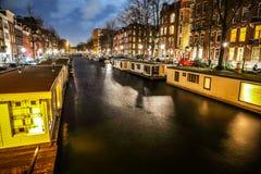 Beautiful night city canals of Amsterdam. AMSTERDAM, NETHERLANDS - JANUARY 12, 2017: Beautiful night city canals of Amsterdam. January 12, 2017 in Amsterdam Stock Images
