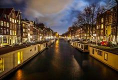 Beautiful night city canals of Amsterdam. AMSTERDAM, NETHERLANDS - JANUARY 12, 2017: Beautiful night city canals of Amsterdam. January 12, 2017 in Amsterdam Stock Photo