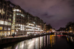 Beautiful night city canals of Amsterdam. AMSTERDAM, NETHERLANDS - JANUARY 12, 2017: Beautiful night city canals of Amsterdam. January 12, 2017 in Amsterdam Stock Image