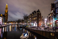 Beautiful night city canals of Amsterdam. AMSTERDAM, NETHERLANDS - JANUARY 12, 2017: Beautiful night city canals of Amsterdam. January 12, 2017 in Amsterdam Royalty Free Stock Photography