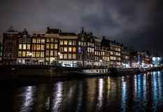 Beautiful night city canals of Amsterdam. AMSTERDAM, NETHERLANDS - JANUARY 12, 2017: Beautiful night city canals of Amsterdam. January 12, 2017 in Amsterdam Royalty Free Stock Photo