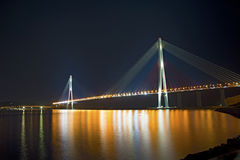 Beautiful night city lights. high bridge across the Bay stretched on pylons. Royalty Free Stock Photography