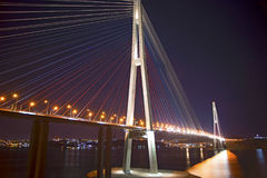 Beautiful night city lights. high bridge across the Bay stretched on pylons. Stock Image