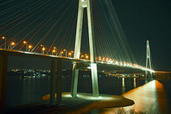 Beautiful night city lights. high bridge across the Bay stretched on pylons. Royalty Free Stock Image