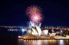 Beautiful night display of colorful fireworks over the Sydney Opera House. Sydney, Australia - March 8, 2018 - Bright bursts of fireworks explode over the Sydney stock images