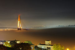 Beautiful night fog covering city and bridge Royalty Free Stock Image