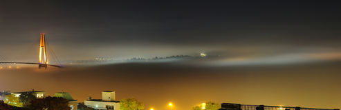Beautiful night fog covering city and bridge on a foggy day Royalty Free Stock Photo