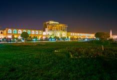 Night illumination in Isfahan, Iran. The beautiful night illumination of Ali Qapu Palace and the garden on Nashq-e Jahad Sqaure, Isfahan, Iran royalty free stock image