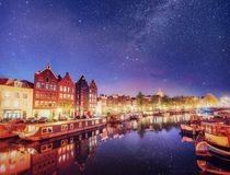 Free Beautiful Night In Amsterdam. Night Illumination Of Buildings And Boats Near The Water In The Canal. Stock Photo - 100572200