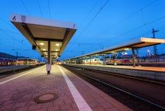 Beautiful night industrial landscape, modern railway station in Nuremberg, Germany. Railroad platform Royalty Free Stock Image