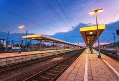 Beautiful night industrial landscape, modern railway station in Nuremberg, Germany. Railroad platform Stock Image