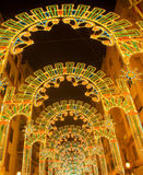Beautiful night lights in Fallas fest of Valencia in calle Sueca. Street Spain Royalty Free Stock Photos