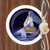 Beautiful night mermaid in porthole Stock Images