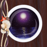 Beautiful night ocean in porthole Royalty Free Stock Photography